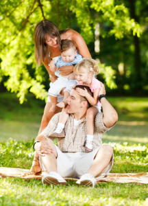 Beautiful family playing in the park